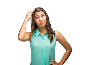 Young latin woman scratching head
