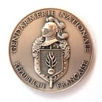 Stamped medal in 3D relief and antic silver plating