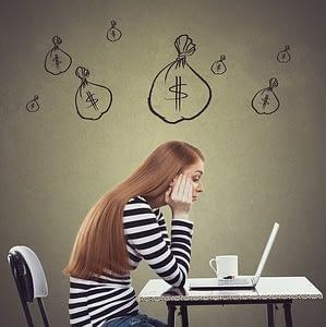 Upset businesswoman working on laptop